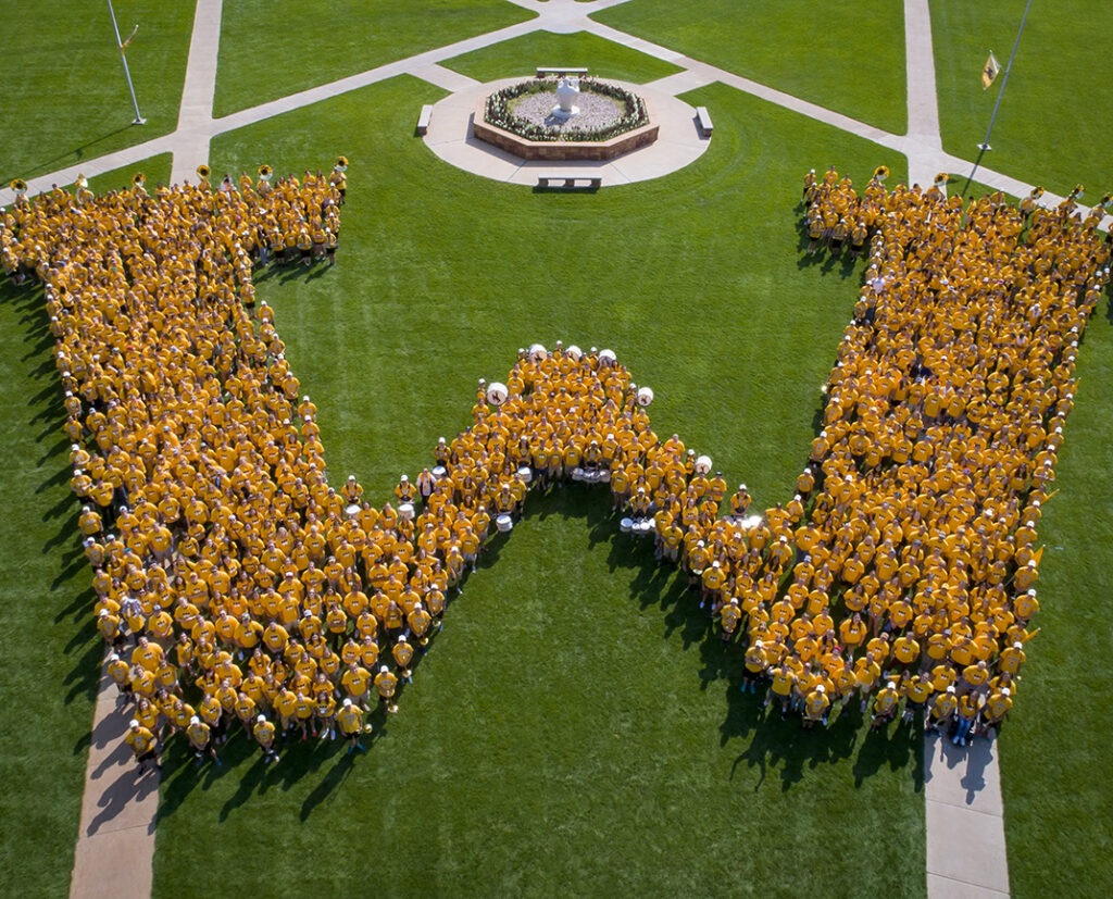 """As part of the freshmen orientation program, Cowboy Connect, the Class of 2021 poses in the shape of a """"W"""" on Prexys Pasture."""